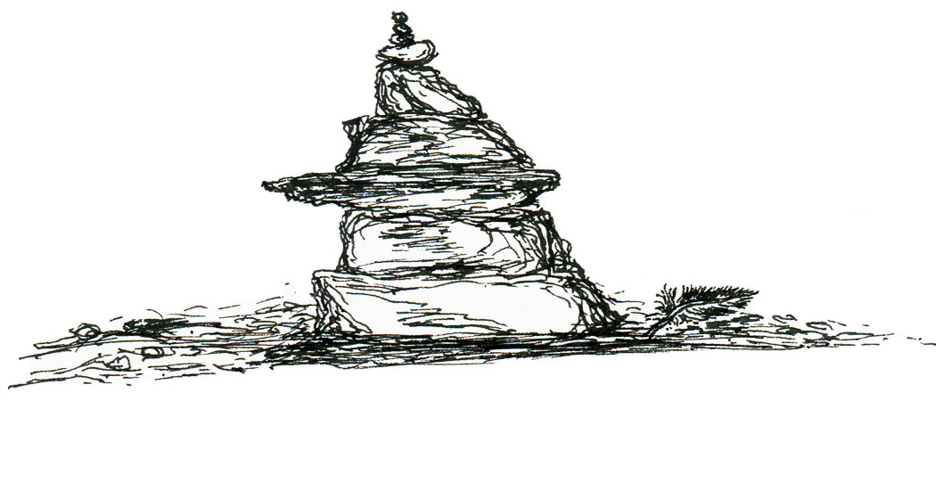 Stone cairn and feather