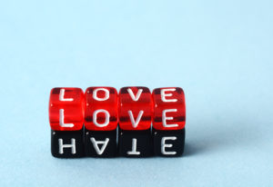 Love and Hate text concept on red and black dices